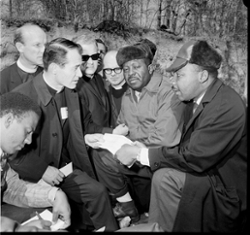Four clergymen speaking to Dr. Martin Luther King jr and two unidentified men.